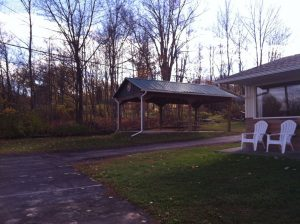 An outdoor pavillion near the woods at Crystal Springs Inn & Suites Towanda, PA